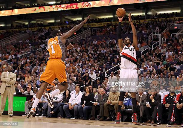 LaMarcus Aldridge of the Portland Trail Blazers puts up a three point shot over Amar'e Stoudemire of the Phoenix Suns during the NBA game at US...