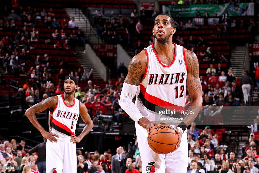 LaMarcus Aldridge #12 of the Portland Trail Blazers shoots a free-throw as teammate Will Barton #5 looks on during a game against the Charlotte Bobcats on March 4, 2013 at the Rose Garden Arena in Portland, Oregon.
