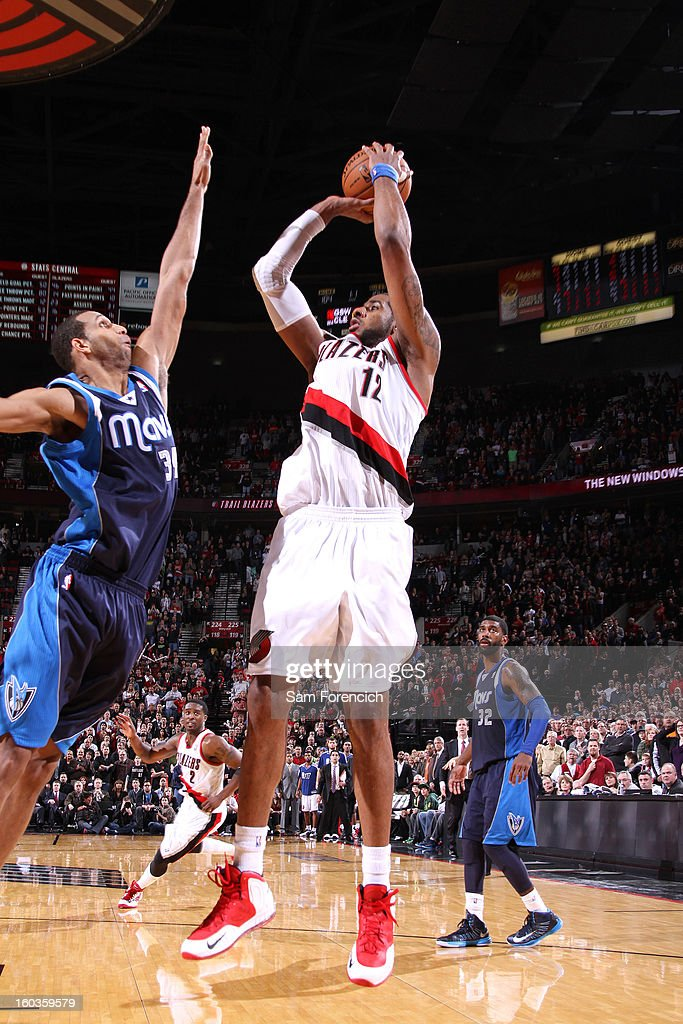 <a gi-track='captionPersonalityLinkClicked' href=/galleries/search?phrase=LaMarcus+Aldridge&family=editorial&specificpeople=453277 ng-click='$event.stopPropagation()'>LaMarcus Aldridge</a> #12 of the Portland Trail Blazers shoots a game-winning shot against <a gi-track='captionPersonalityLinkClicked' href=/galleries/search?phrase=Brandan+Wright&family=editorial&specificpeople=3847557 ng-click='$event.stopPropagation()'>Brandan Wright</a> #34 of the Dallas Mavericks during the game on January 29, 2013 at the Rose Garden Arena in Portland, Oregon.