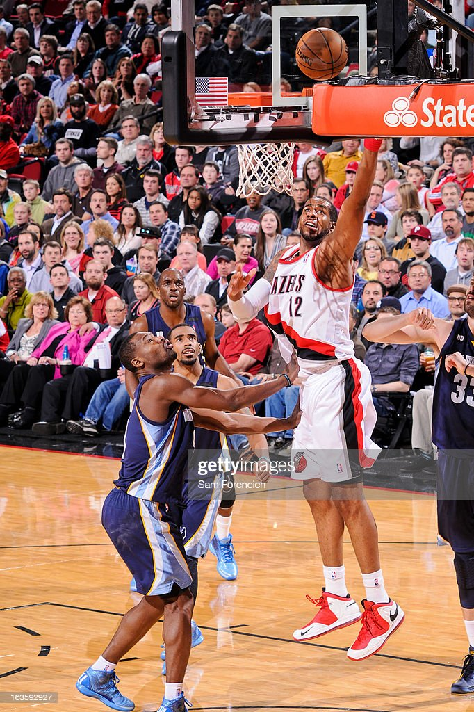 LaMarcus Aldridge #12 of the Portland Trail Blazers shoots a layup against Tony Allen #9 of the Memphis Grizzlies on March 12, 2013 at the Rose Garden Arena in Portland, Oregon.