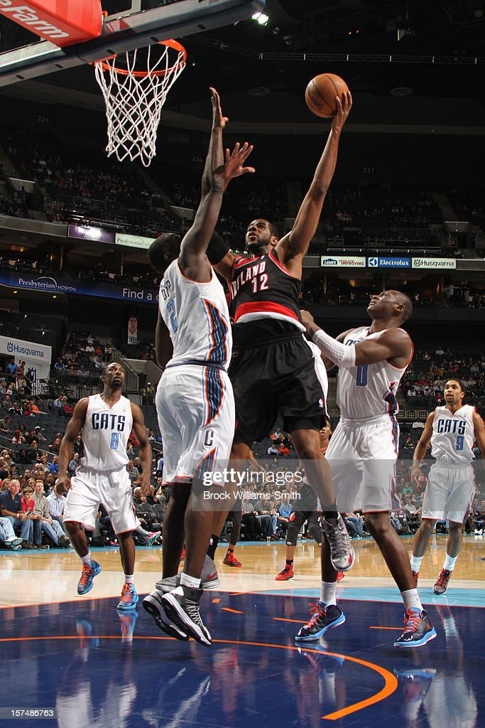LaMarcus Aldridge #12 of the Portland Trail Blazers shoots against DeSagana Diop #2 of the Charlotte Bobcats at the Time Warner Cable Arena on December 3, 2012 in Charlotte, North Carolina.