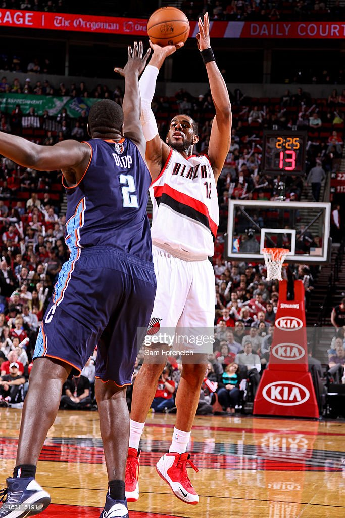 LaMarcus Aldridge #12 of the Portland Trail Blazers shoots against DeSagana Diop #2 of the Charlotte Bobcats on March 4, 2013 at the Rose Garden Arena in Portland, Oregon.