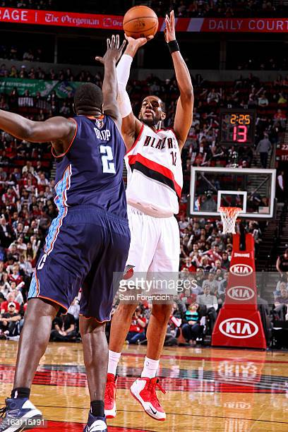 LaMarcus Aldridge of the Portland Trail Blazers shoots against DeSagana Diop of the Charlotte Bobcats on March 4 2013 at the Rose Garden Arena in...