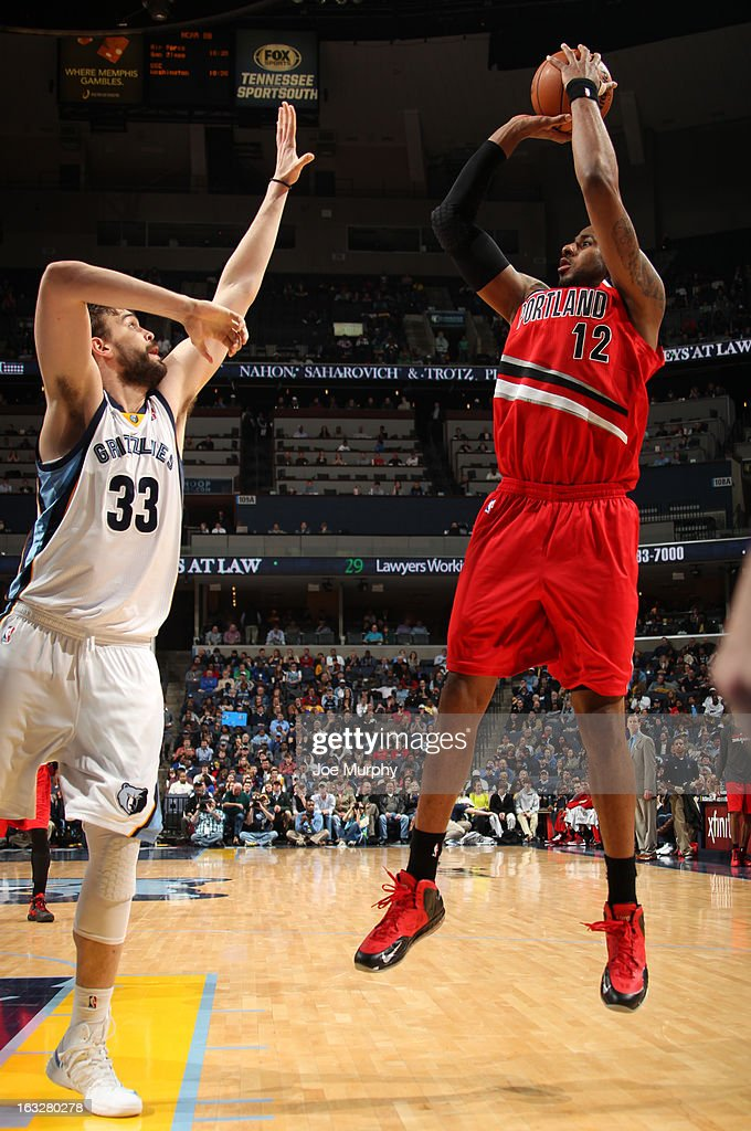 LaMarcus Aldridge #12 of the Portland Trail Blazers shoots against Marc Gasol #33 of the Memphis Grizzlies on March 6, 2013 at FedExForum in Memphis, Tennessee.