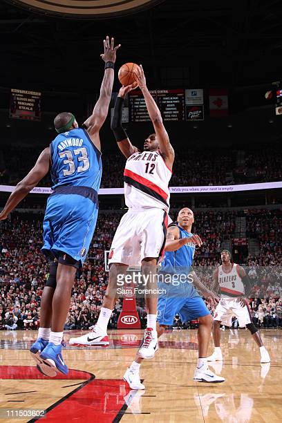 LaMarcus Aldridge of the Portland Trail Blazers shoots against Brendan Haywood of the Dallas Mavericks on April 3 2011 at the Rose Garden Arena in...