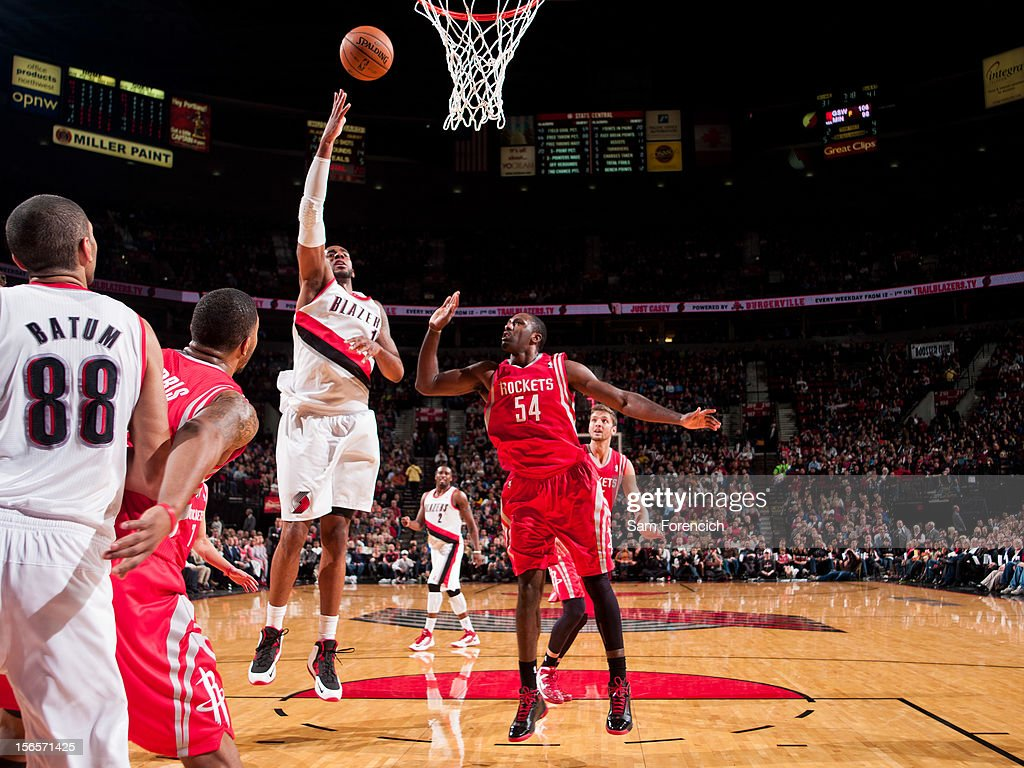 <a gi-track='captionPersonalityLinkClicked' href=/galleries/search?phrase=LaMarcus+Aldridge&family=editorial&specificpeople=453277 ng-click='$event.stopPropagation()'>LaMarcus Aldridge</a> #12 of the Portland Trail Blazers shoots in the lane against <a gi-track='captionPersonalityLinkClicked' href=/galleries/search?phrase=Patrick+Patterson&family=editorial&specificpeople=2928099 ng-click='$event.stopPropagation()'>Patrick Patterson</a> #54 of the Houston Rockets on November 16, 2012 at the Rose Garden Arena in Portland, Oregon.