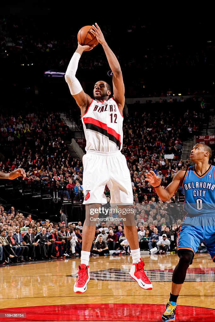 LaMarcus Aldridge #12 of the Portland Trail Blazers shoots in the lane against Russell Westbrook #0 of the Oklahoma City Thunder on January 13, 2013 at the Rose Garden Arena in Portland, Oregon.