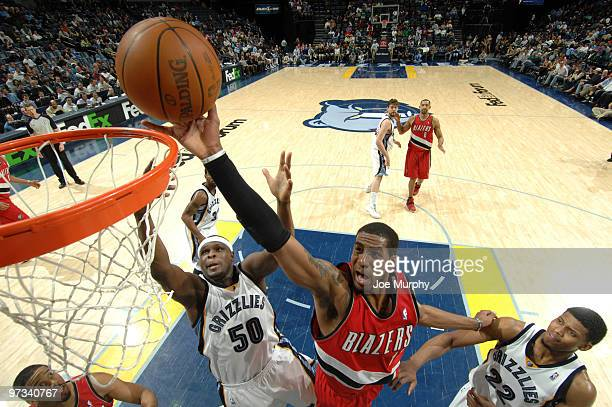LaMarcus Aldridge of the Portland Trail Blazers shoots over Zach Randolph and Rudy Gay of the Memphis Grizzlies on March 1 2009 at FedExForum in...
