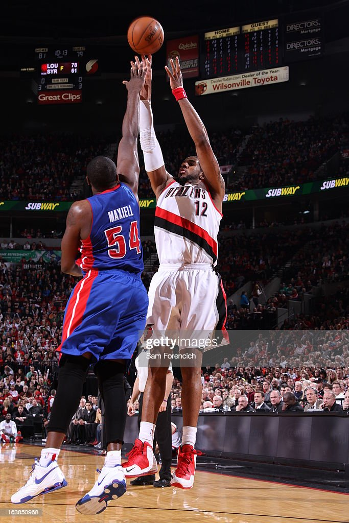LaMarcus Aldridge #12 of the Portland Trail Blazers shoots the ball over Jason Maxiell #54 of the Detroit Pistons during the game between the Detroit Pistons and the Portland Trail Blazers on March 16, 2013 at the Rose Garden Arena in Portland, Oregon.