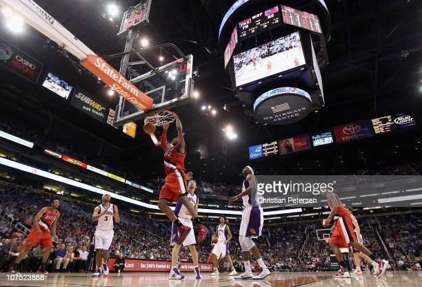 LaMarcus Aldridge of the Portland Trail Blazers slam dunks the ball past Hedo Turkoglu of the Phoenix Suns during the NBA game at US Airways Center...