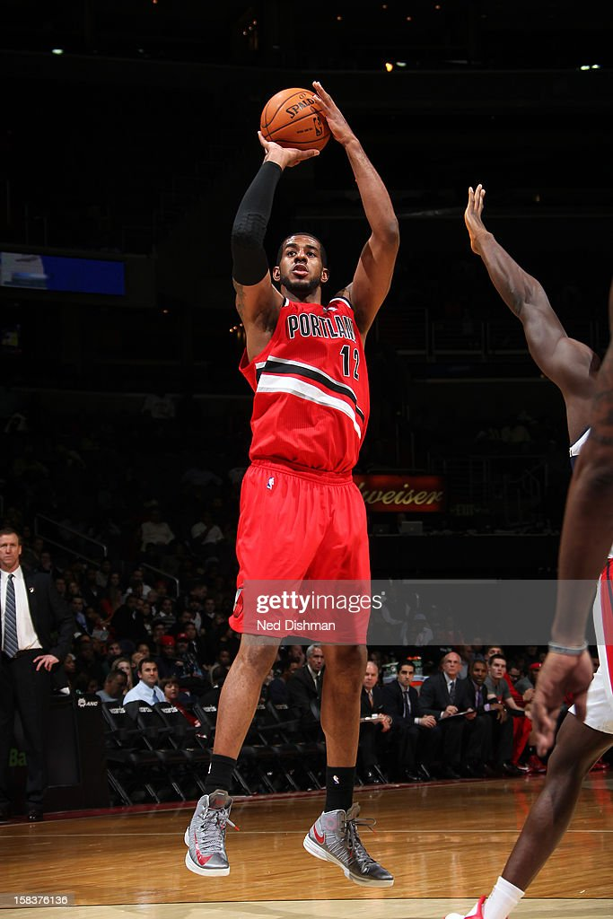 <a gi-track='captionPersonalityLinkClicked' href=/galleries/search?phrase=LaMarcus+Aldridge&family=editorial&specificpeople=453277 ng-click='$event.stopPropagation()'>LaMarcus Aldridge</a> #12 of the Portland Trail Blazers takes a shot against the Washington Wizards at the Verizon Center on November 28, 2012 in Washington, DC.