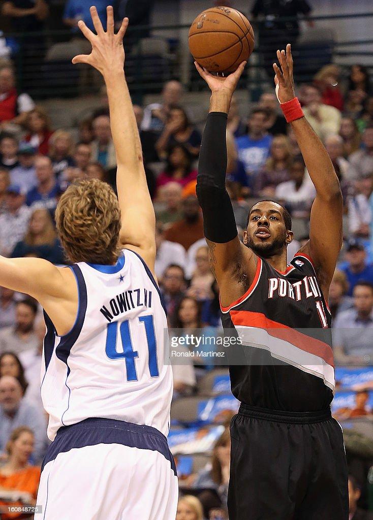 LaMarcus Aldridge #12 of the Portland Trail Blazers takes a shot against Dirk Nowitzki #41 of the Dallas Mavericks at American Airlines Center on February 6, 2013 in Dallas, Texas.