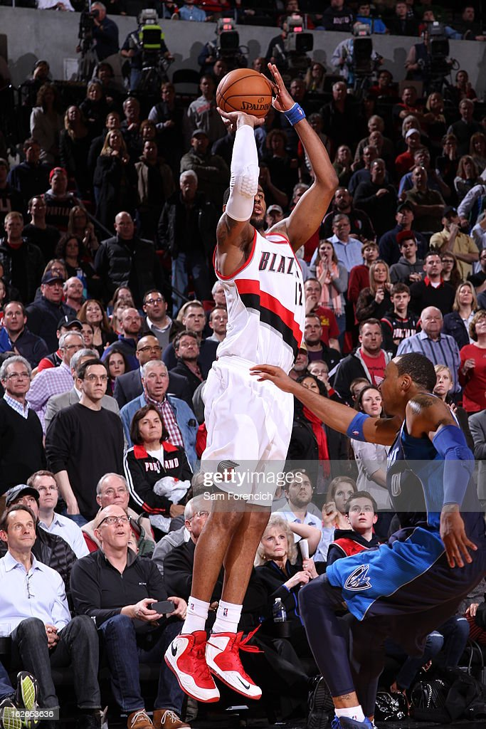<a gi-track='captionPersonalityLinkClicked' href=/galleries/search?phrase=LaMarcus+Aldridge&family=editorial&specificpeople=453277 ng-click='$event.stopPropagation()'>LaMarcus Aldridge</a> #12 of the Portland Trail Blazers takes a shot against the Dallas Mavericks on January 29, 2013 at the Rose Garden Arena in Portland, Oregon.