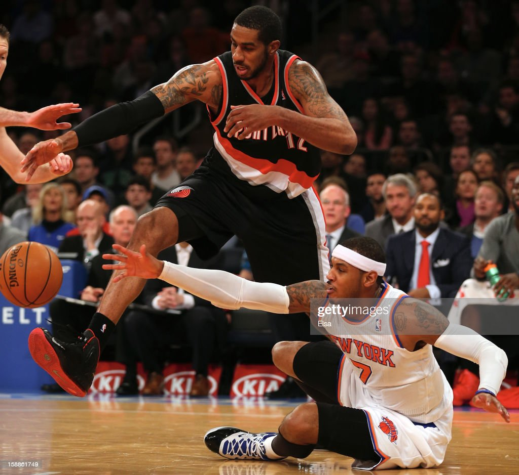 LaMarcus Aldridge #12 of the Portland Trail Blazers tries to keep the ball from Carmelo Anthony #7 of the New York Knicks on January 1, 2013 at Madison Square Garden in New York City.