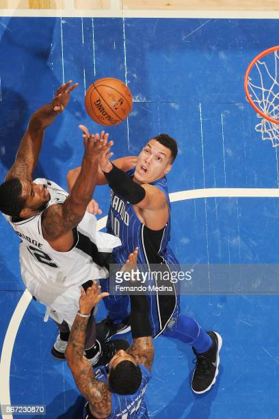 LaMarcus Aldridge of the San Antonio Spurs and Aaron Gordon of the Orlando Magic vie for the ball during the game on October 27 2017 at Amway Center...