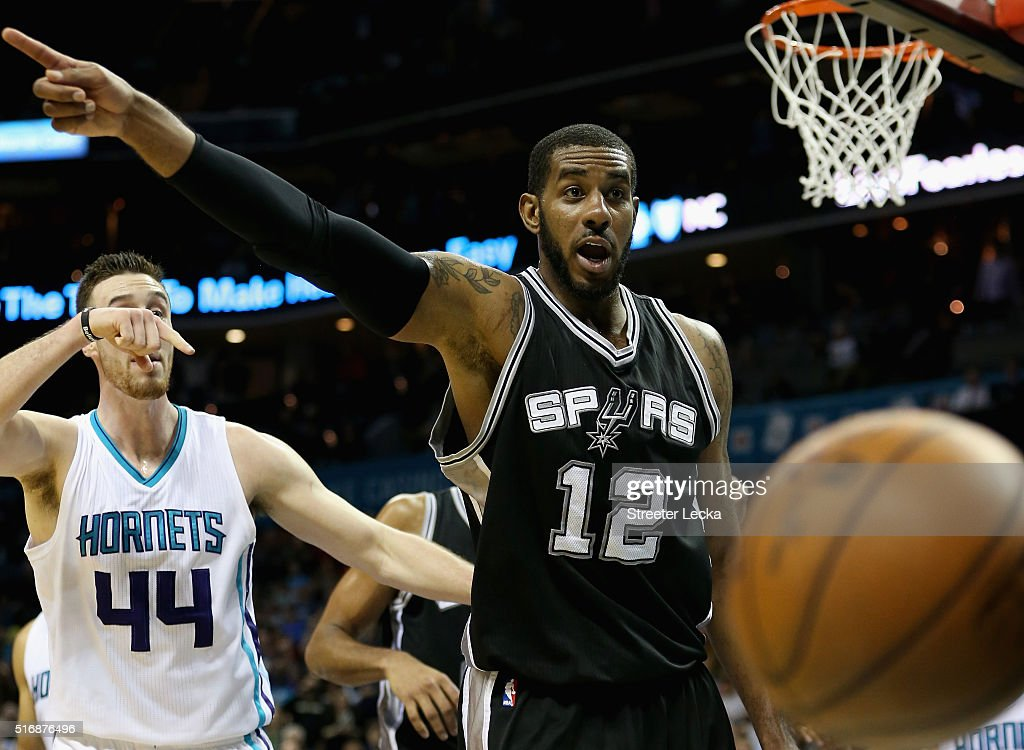 LaMarcus Aldridge #12 of the San Antonio Spurs and Frank Kaminsky #44 of the Charlotte Hornets react before a call during their game at Time Warner Cable Arena on March 21, 2016 in Charlotte, North Carolina.NOTE