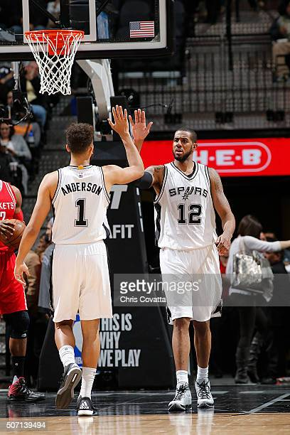 LaMarcus Aldridge of the San Antonio Spurs and Kyle Anderson of the San Antonio Spurs shake hands during the game against the Houston Rockets on...