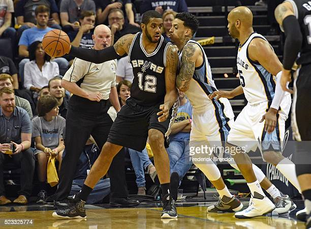 LaMarcus Aldridge of the San Antonio Spurs dribbles against Matt Barnes of the Memphis Grizzlies during the first half of game three of the Western...