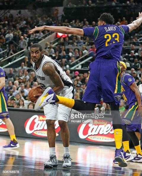 LaMarcus Aldridge of the San Antonio Spurs drives past Anthony Davis of the New Orleans Pelicans at ATT Center on February 3 2016 in San Antonio...