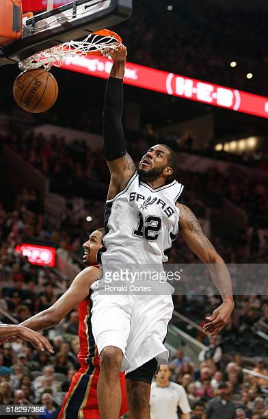 LaMarcus Aldridge of the San Antonio Spurs dunks against the New Orleans Pelicans at ATT Center on March 30 2016 in San Antonio Texas NOTE TO USER...