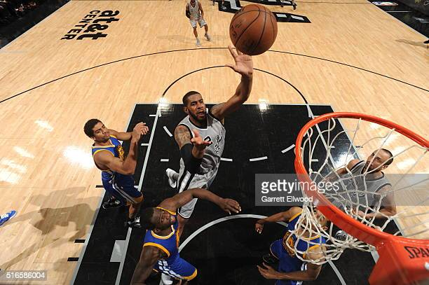 LaMarcus Aldridge of the San Antonio Spurs goes to the basket against the Golden State Warriors on March 19 2016 at the ATT Center in San Antonio...
