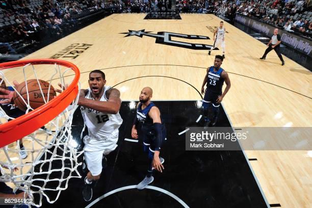 LaMarcus Aldridge of the San Antonio Spurs goes to the basket against the Minnesota Timberwolves on October 18 2017 at the ATT Center in San Antonio...
