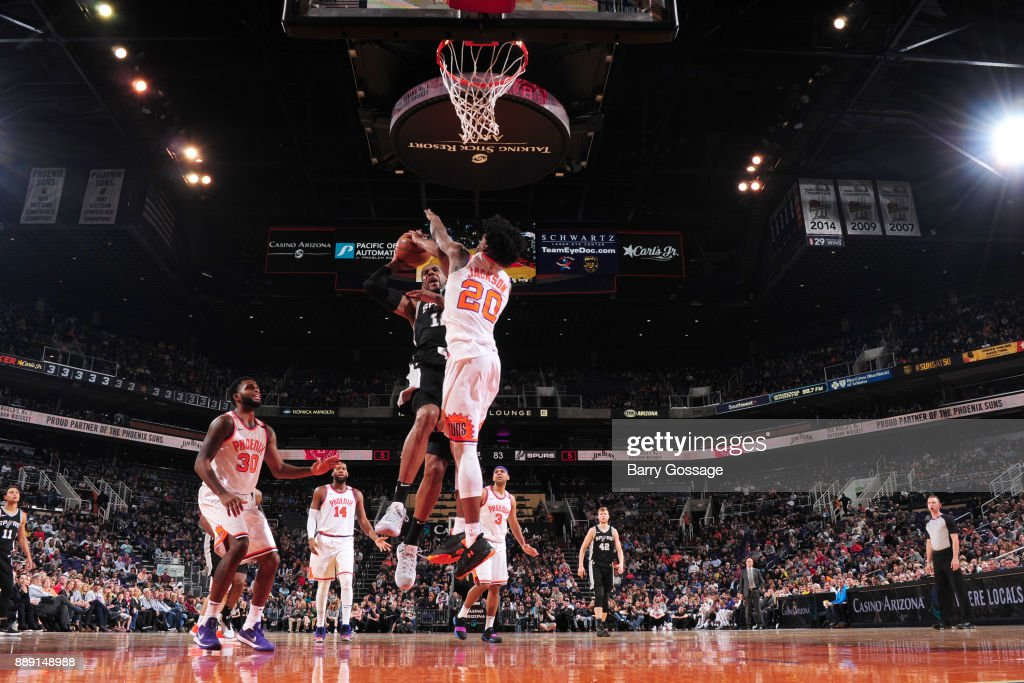 LaMarcus Aldridge #12 of the San Antonio Spurs goes to the basket against the Phoenix Suns on December 9, 2017 at Talking Stick Resort Arena in Phoenix, Arizona.