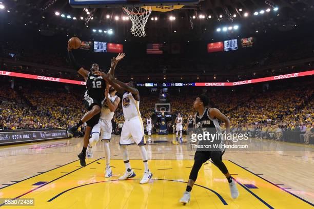 LaMarcus Aldridge of the San Antonio Spurs goes up for a dunk against the Golden State Warriors during Game One of the NBA Western Conference Finals...