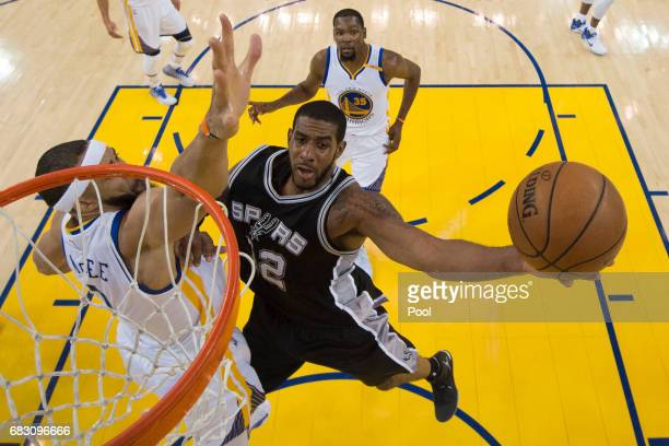 LaMarcus Aldridge of the San Antonio Spurs goes up for a shot against JaVale McGee of the Golden State Warriors during Game One of the NBA Western...