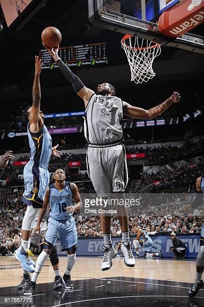 LaMarcus Aldridge of the San Antonio Spurs grabs the rebound against the Memphis Grizzlies on March 25 2016 at the ATT Center in San Antonio Texas...