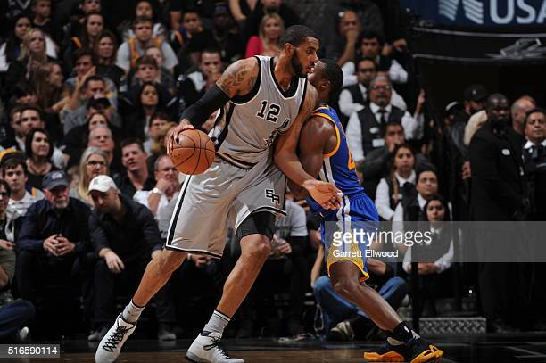 LaMarcus Aldridge of the San Antonio Spurs handles the ball against the Golden State Warriors on March 19 2016 at the ATT Center in San Antonio Texas...