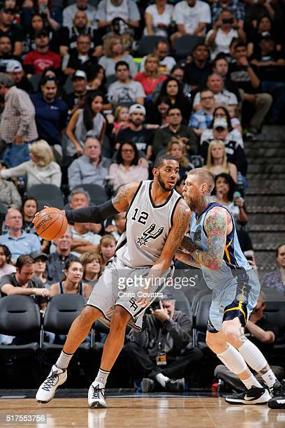 LaMarcus Aldridge of the San Antonio Spurs handles the ball against the Memphis Grizzlies on March 25 2016 at the ATT Center in San Antonio Texas...
