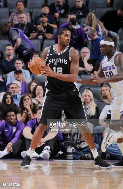 LaMarcus Aldridge of the San Antonio Spurs handles the ball against the Sacramento Kings on October 2 2017 at Golden 1 Center in Sacramento...