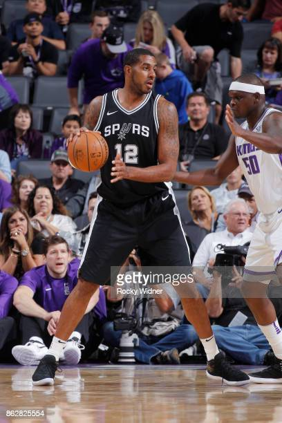 LaMarcus Aldridge of the San Antonio Spurs handles the ball against Zach Randolph of the Sacramento Kings on October 2 2017 at Golden 1 Center in...