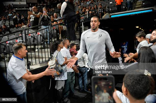 LaMarcus Aldridge of the San Antonio Spurs high fives fans before the game against the Minnesota Timberwolves on October 18 2017 at the ATT Center in...