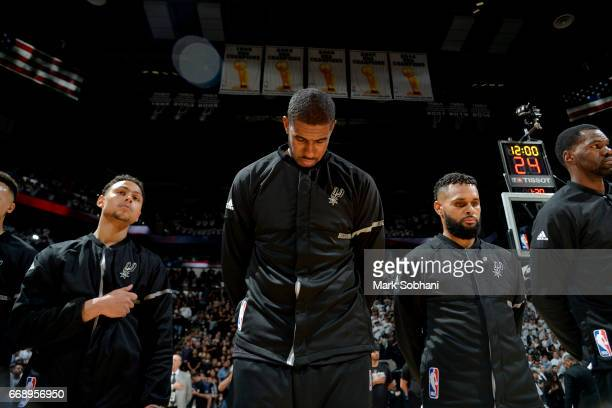 LaMarcus Aldridge of the San Antonio Spurs honors the National Anthem before the game against the Memphis Grizzlies in Game One of Round One during...