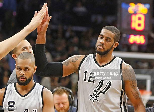 LaMarcus Aldridge of the San Antonio Spurs is congratulated by teammates in Game One of the Western Conference Quarterfinals during the 2016 NBA...
