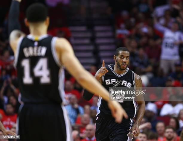 LaMarcus Aldridge of the San Antonio Spurs reacts towards Danny Green against the Houston Rockets during Game Six of the NBA Western Conference...