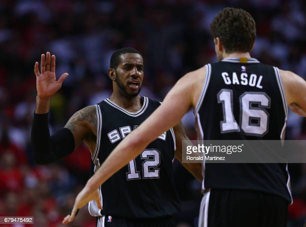 LaMarcus Aldridge of the San Antonio Spurs reacts with Pau Gasol against the Houston Rockets during Game Three of the NBA Western Conference...