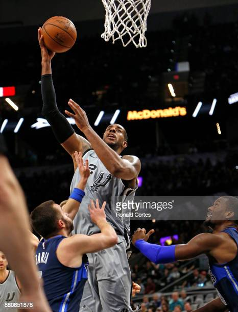 LaMarcus Aldridge of the San Antonio Spurs scores over JJ Barea of the Dallas Mavericks at ATT Center on November 27 2017 in San Antonio Texas NOTE...
