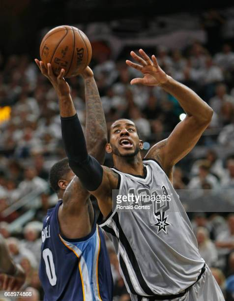 LaMarcus Aldridge of the San Antonio Spurs scores past JaMychal Green of the Memphis Grizzlies in Game One of the Western Conference Quarterfinals...