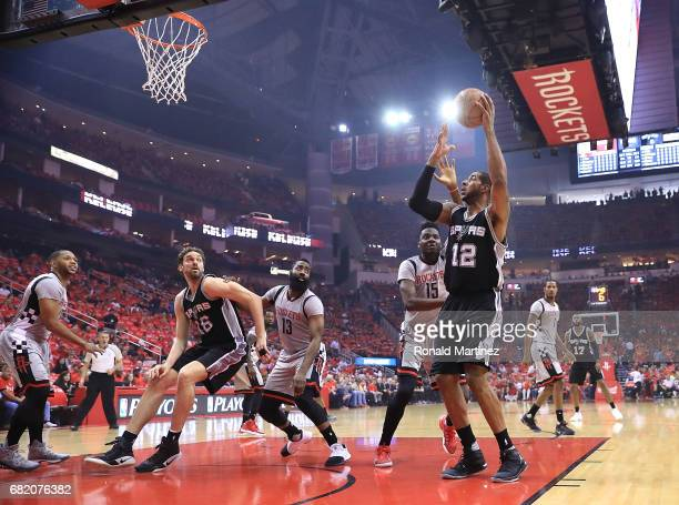 LaMarcus Aldridge of the San Antonio Spurs shoots against Clint Capela of the Houston Rockets during Game Six of the NBA Western Conference...