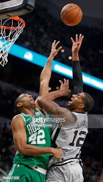 LaMarcus Aldridge of the San Antonio Spurs shoots over Al Horford of the Boston Celtics at ATT Center on December 08 2017 in San Antonio Texas NOTE...