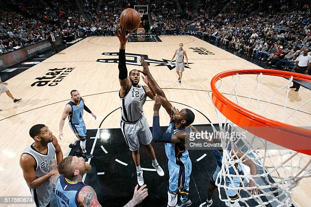 LaMarcus Aldridge of the San Antonio Spurs shoots the ball against the Memphis Grizzlies on March 25 2016 at the ATT Center in San Antonio Texas NOTE...