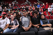 LaMarcus Aldridge of the San Antonio Spurs takes a picture with some fans before the game against the Portland Trail Blazers on November 11 2015 at...