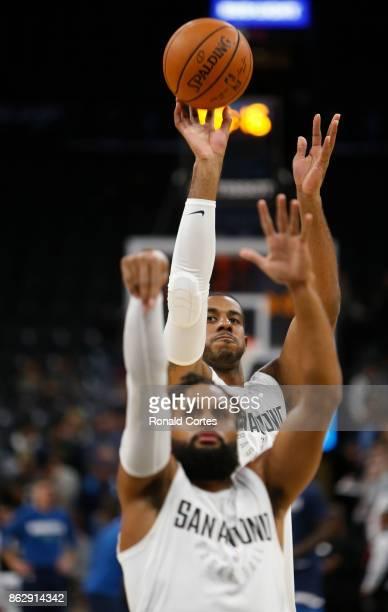 LaMarcus Aldridge of the San Antonio Spurs takes a practice shot behind Patty Mills of the San Antonio Spurs before the start of their game against...