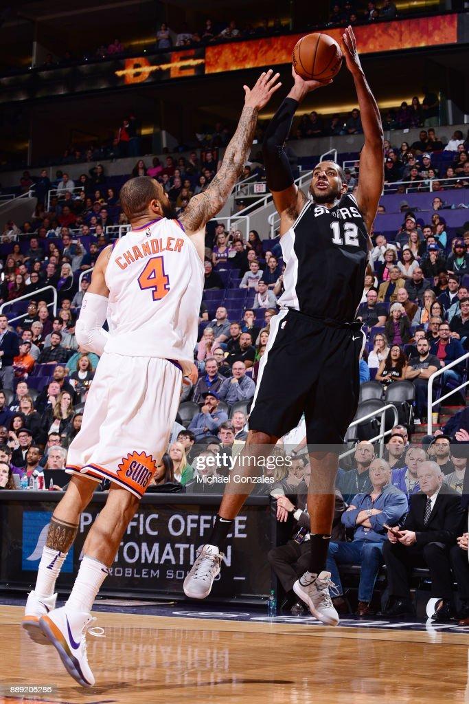LaMarcus Aldridge #12 of the San Antonio Spurs takes the shot against the Phoenix Suns on December 9, 2017 at Talking Stick Resort Arena in Phoenix, Arizona.