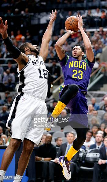 LaMarcus Aldridge of the San Antonio Spurs tries to block the shot of Anthony Davis of the New Orleans Pelicans at ATT Center on February 3 2016 in...