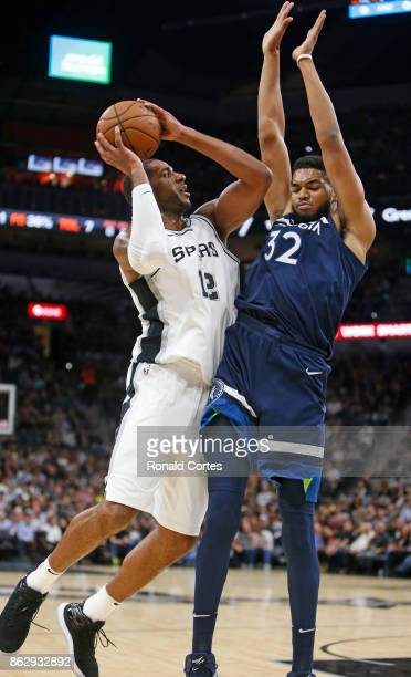 LaMarcus Aldridge of the San Antonio Spurs tries to score over KarlAnthony Towns of the Minnesota Timberwolves at ATT Center on October 18 2017 in...