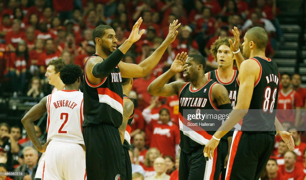<a gi-track='captionPersonalityLinkClicked' href=/galleries/search?phrase=LaMarcus+Aldridge&family=editorial&specificpeople=453277 ng-click='$event.stopPropagation()'>LaMarcus Aldridge</a> #12, <a gi-track='captionPersonalityLinkClicked' href=/galleries/search?phrase=Wesley+Matthews+-+Basketball+Player&family=editorial&specificpeople=804816 ng-click='$event.stopPropagation()'>Wesley Matthews</a> #2, <a gi-track='captionPersonalityLinkClicked' href=/galleries/search?phrase=Robin+Lopez&family=editorial&specificpeople=2351509 ng-click='$event.stopPropagation()'>Robin Lopez</a> #4 and <a gi-track='captionPersonalityLinkClicked' href=/galleries/search?phrase=Nicolas+Batum&family=editorial&specificpeople=3746275 ng-click='$event.stopPropagation()'>Nicolas Batum</a> #88 of the Portland Trail Blazers celebrate a play on the court in the first half of the game against the Houston Rockets in Game Two of the Western Conference Quarterfinals during the 2014 NBA Playoffs at Toyota Center on April 23, 2014 in Houston, Texas.